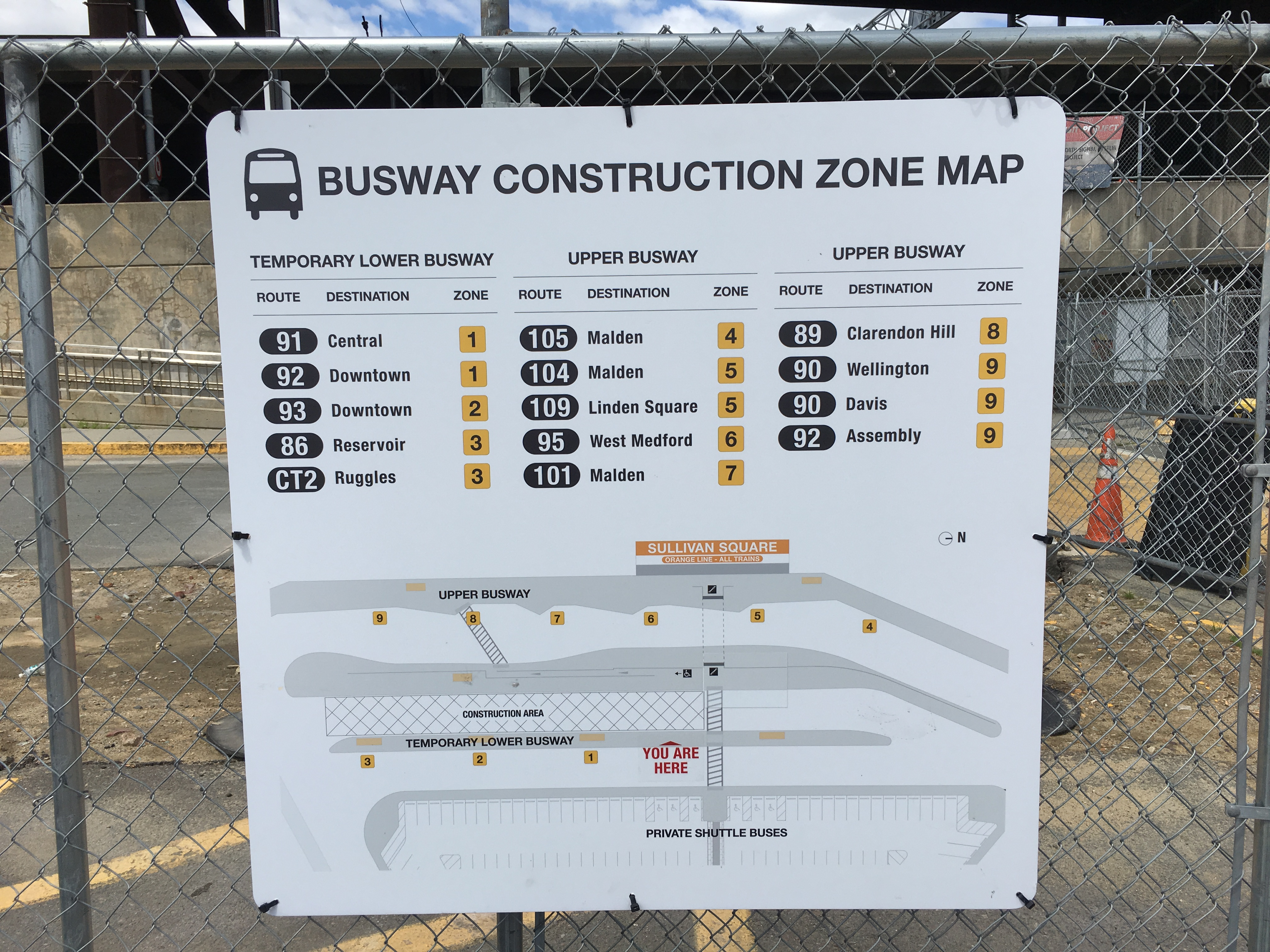 A square map ziptied to a chain link fence, titled Busway Construction Zone Map