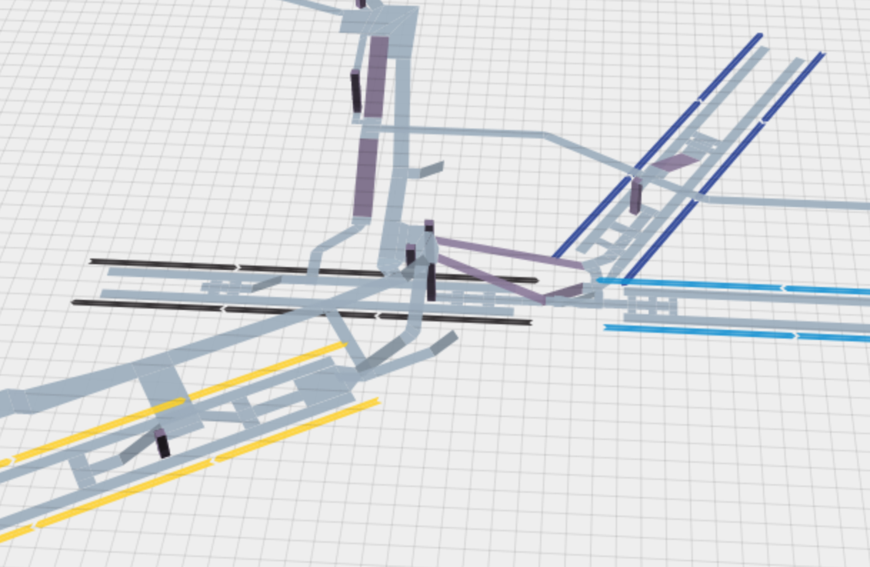 A 3d computer model of a the platforms and hallways of a station. There are 4 subway lines going through it, all with center platforms. There are staircases, elevators, and hallways linking all of the platforms.
